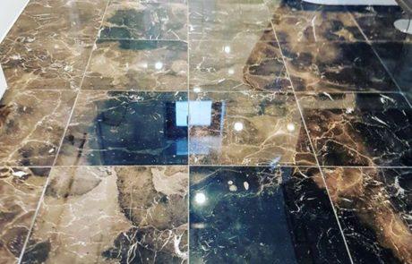 High polished finish on newly tiled emprador marble bathroom floor